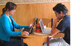 Mark & Magda doing some work in the cafeteria during a break in their Spanish lessons