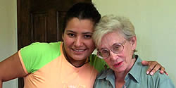Nancy Parsly with her teacher Lorena Pitt, current School Director, in one of the School's hallways